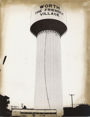 Black and white photo of the Worth water tower - Worth The Friendly Village